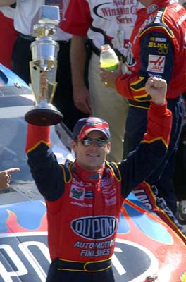 Jeff Gordon holds up Brickyard 400 trophy